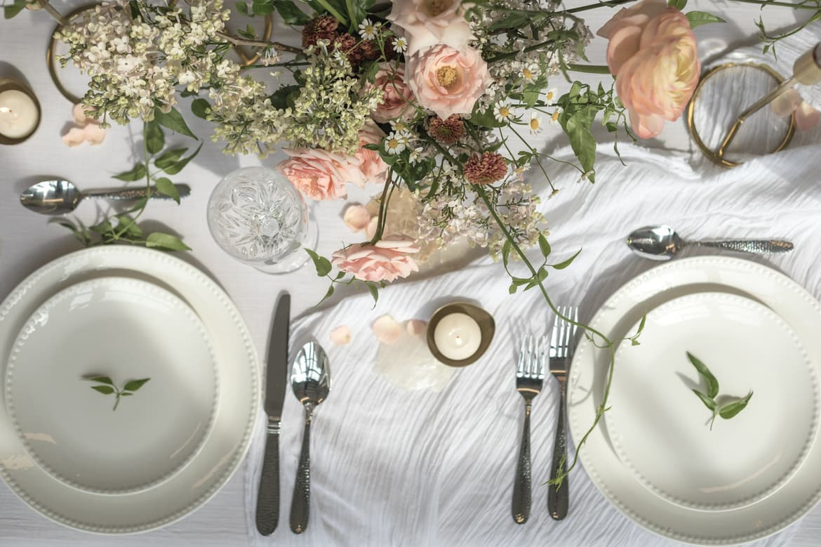 a-dining-table-filled-with-floral-decoration.jpg